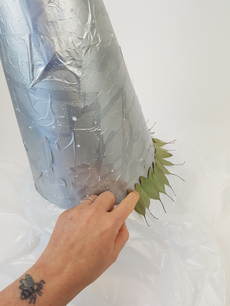 Glue leaves around the cone shape