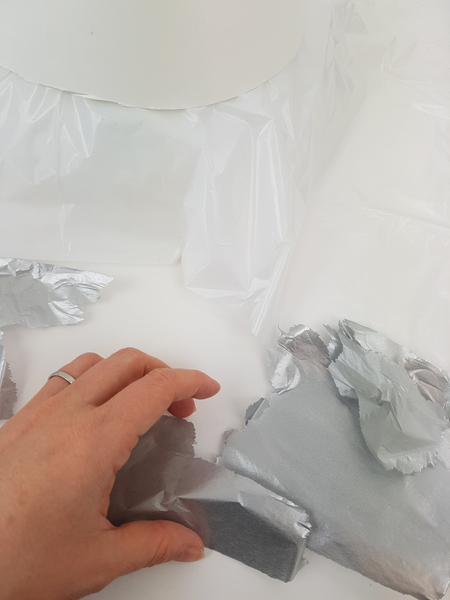 Rip up silver tissue paper