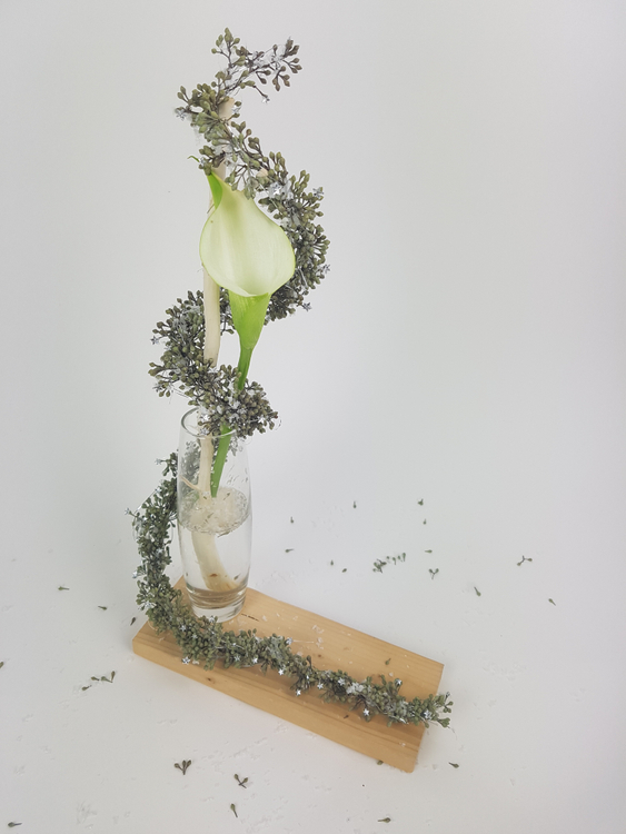 Eucalyptus tinsel garland with an arum lily floral design