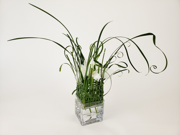 Lily and lily grass flower arrangement.