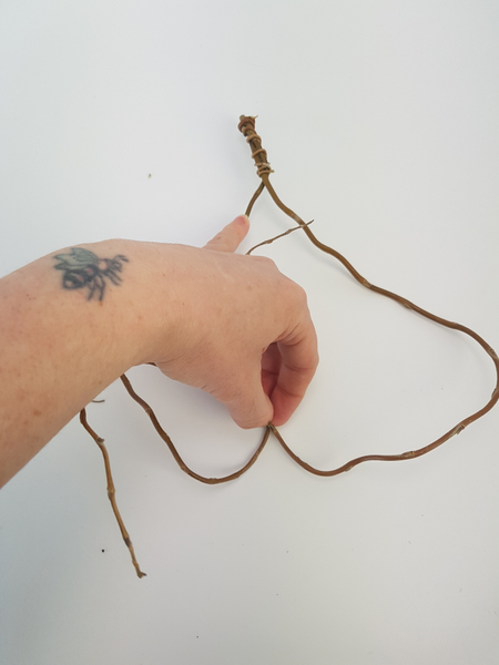 Shape the two willow twigs to create a heart
