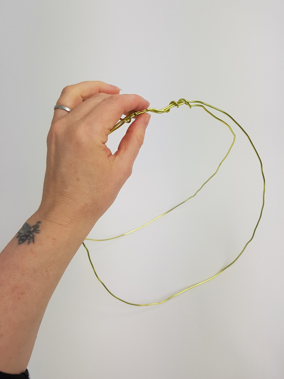 Secure the wire at one end to create the basket handle