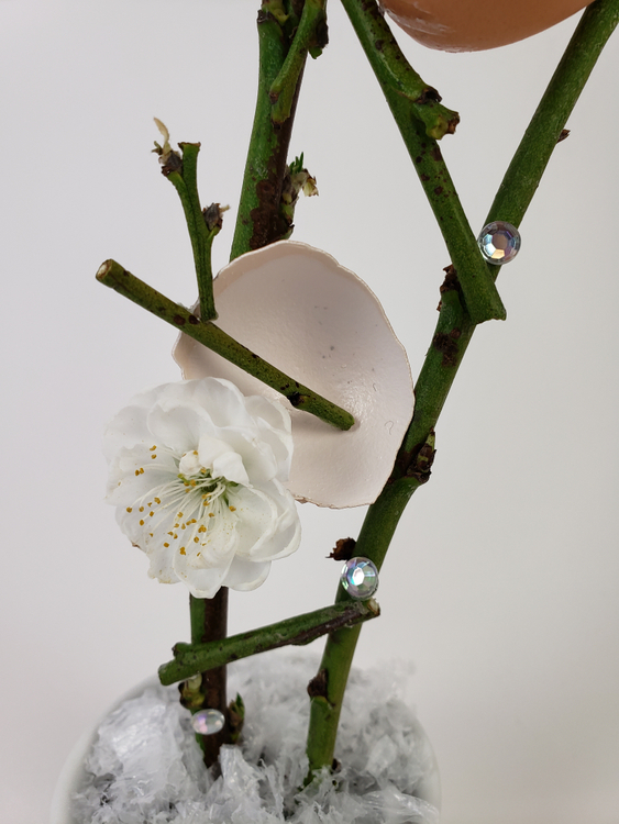 Blossom and eggshell floral design