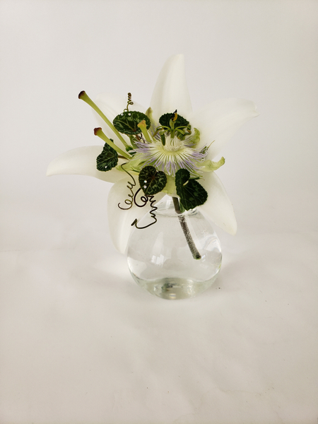 A trumpet shaped lily floral design