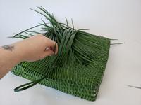 Taking a break when weaving with grass