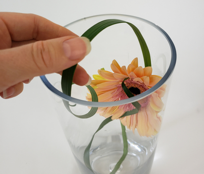 Letting grass kick against the side of the vase to create a neat and minimal line