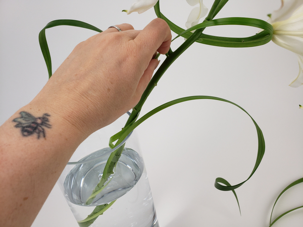Place the flower stem in a vase