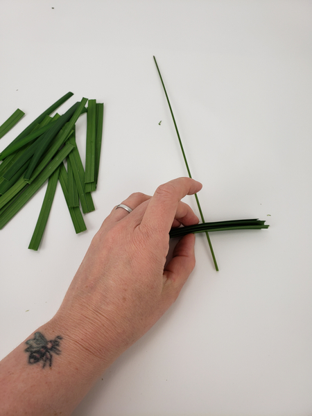 Thread the lily grass sections into the flexi grass