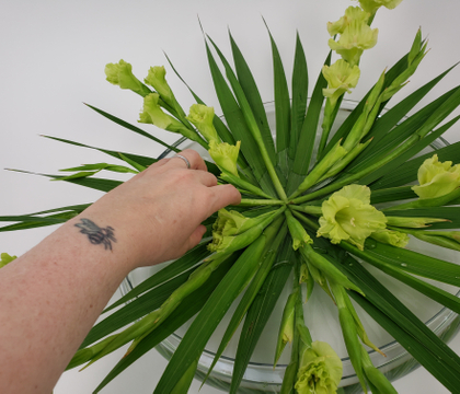 A Three level Kenzan skewer stack to Radiate Gladiolus spikes flat in a shallow container