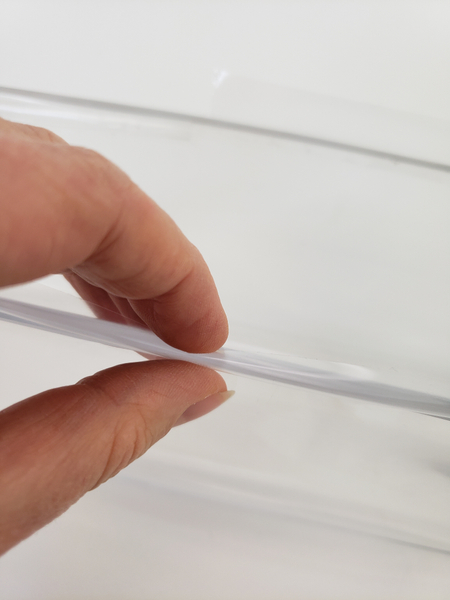 Roll the tape back so that it sticks to itself creating a clear double sided sticky tape