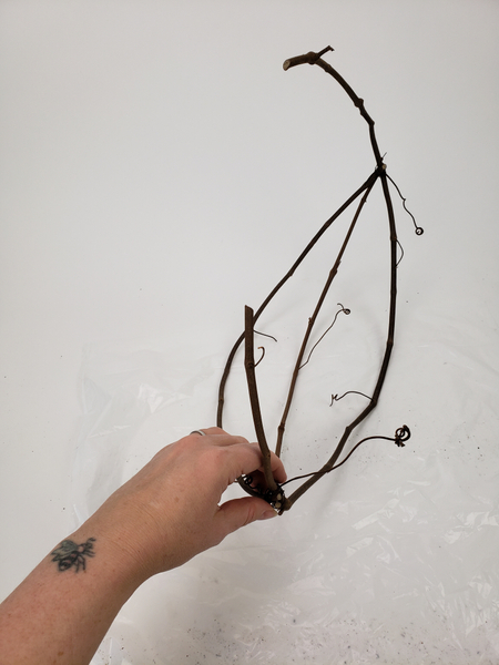 And wire the vine ends tightly together