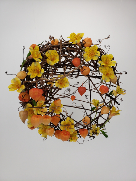 Creative and sustainable contemporary flower arrangement for autumn using twigs and Physalis and Alstroemeria by Christine de Beer