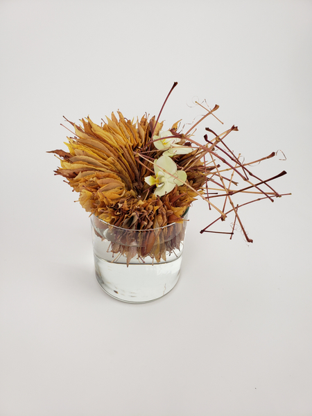 Thanksgiving table arrangement made from gathered fall leaves