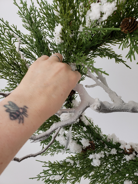 Add in a snow covered branch