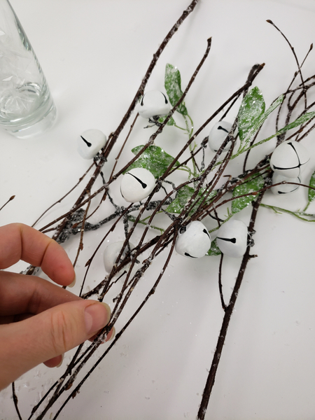 Build up the twig armature by adding the twigs and twisting the wires to secure them in place