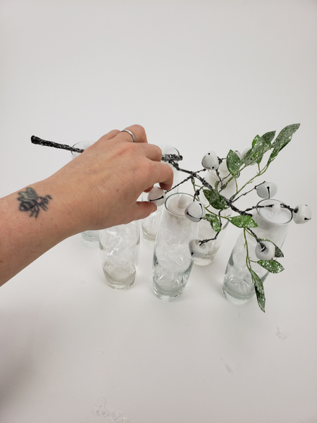 Measure the artificial branch against the vases you want to display the design on