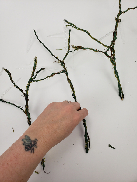 When most of the wire is covered in twigs add the decorative twigs