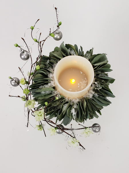 Use a battery powered candle for a long lasting Christmas floral display