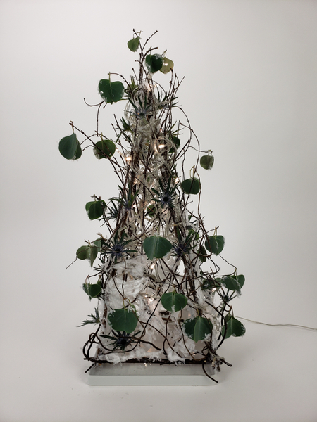 Use twigs to make a table top Christmas tree