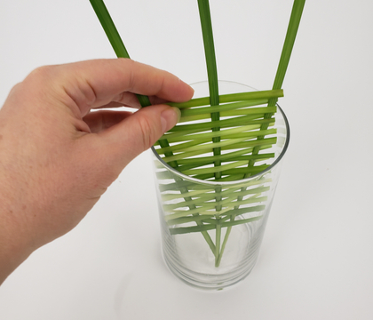 Over and under weave floral panel armature for inside a vase