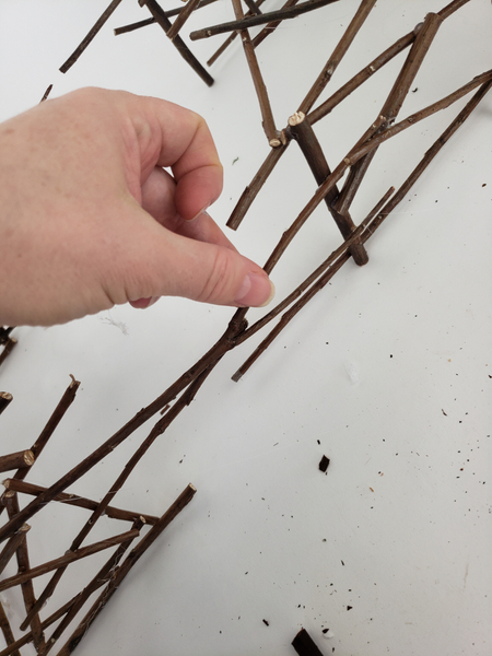 Glue in twigs that reaches over the gap