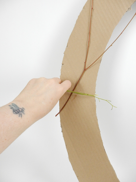 Wrap fresh eucalyptus stems around the cardboard