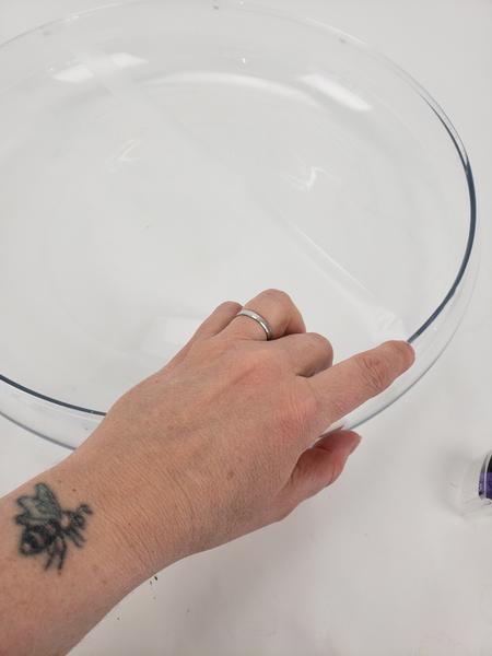 Stick down a grid of clear sticky tape over a shallow container
