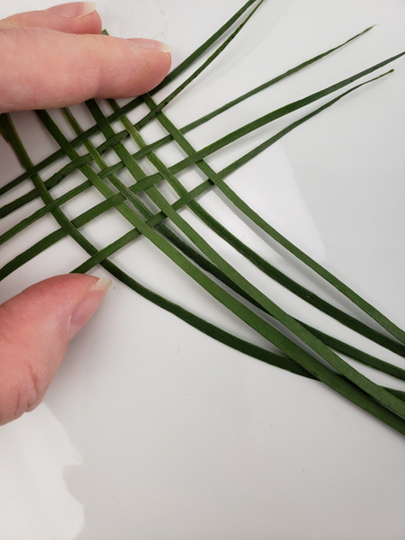 Weave a few blades of grass or palm to create a small basket weave