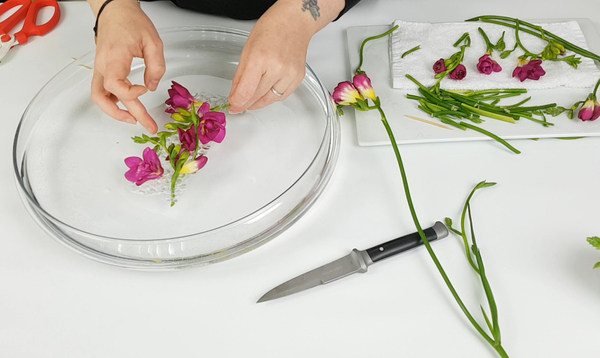 Build up the design by poking holes and adding the stems