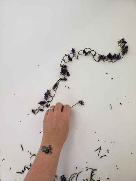 Crafting a long and continuous lavender garland.