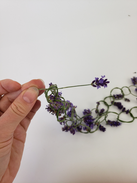 Knot the two ends together with a lavender flower