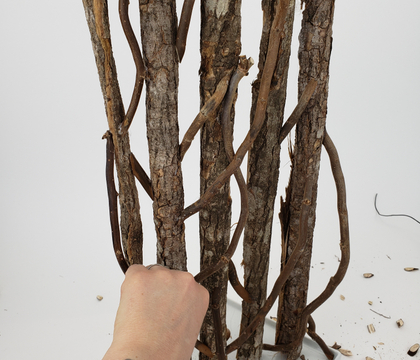 a Just-Replace-The-Flowers-When-They-Wilt freestanding bark armature