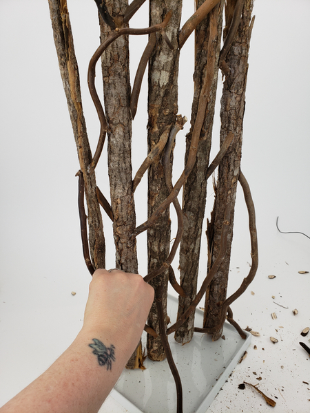 Simply glue in side twigs to kick against the corners of the display container