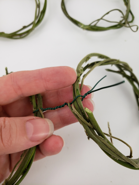 Extend the wire twist to the second wreath