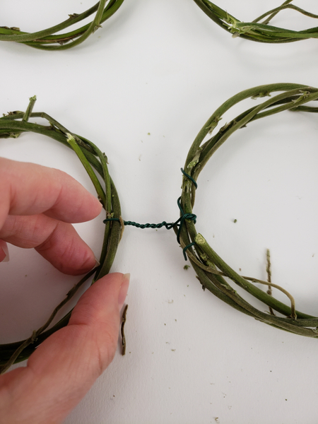 Fold the wire ends in and around the wreath so that it can't catch on anything