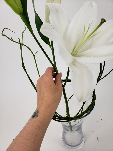 Place the flower stem in the vase