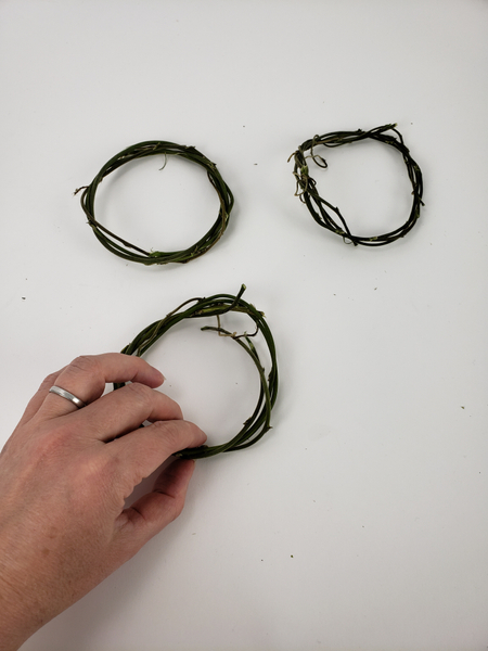 Weave a third wreath exactly the same size as the two before