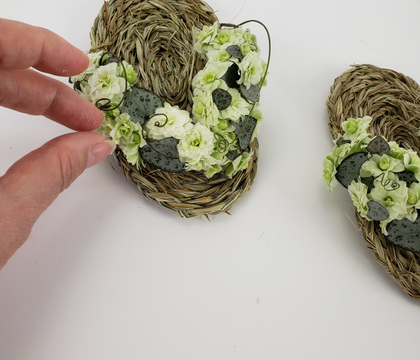 Adding flowers to those pretty hand coiled flip flops I made for my book
