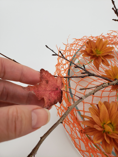 Glue in some dried autumn leaves