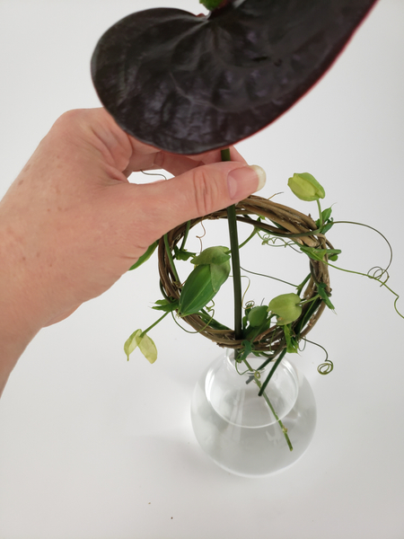 Place a heavy anthurium stem between the two wreaths