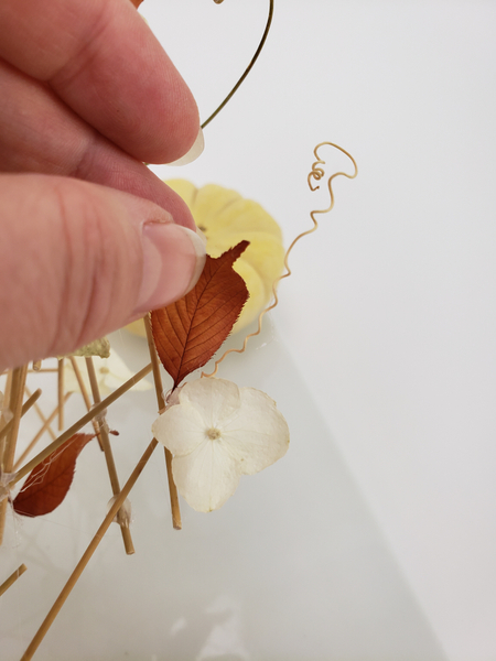 Reshape and glue in a few autumn leaves