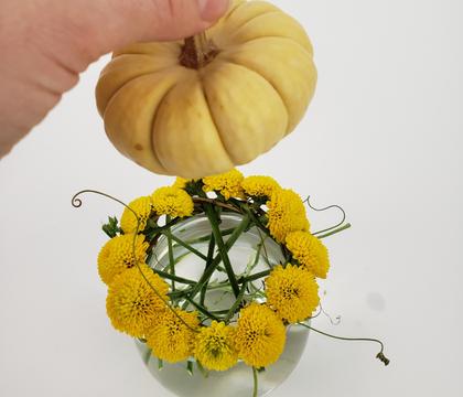 Floral wreath ring stem armature for a cute pumpkin patch in a stem vase design