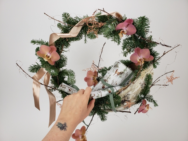 Craft a wreath with a special place to put small gifts for contact free gift pick up or delivery