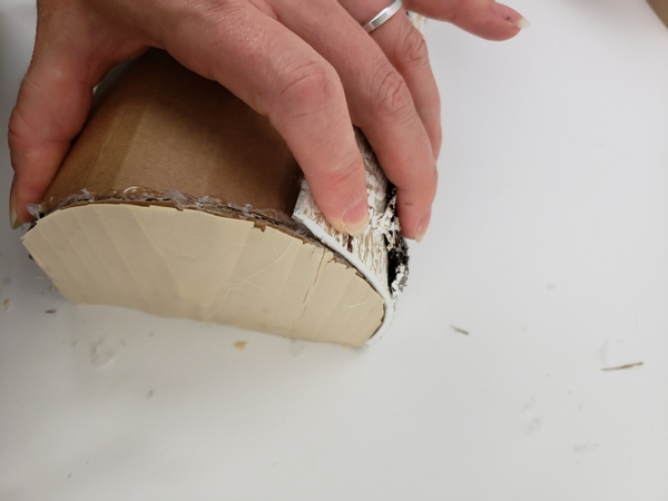 Fold the bark under the log shape and secure with glue