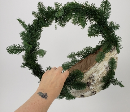 Contactless gift exchange wreath perfect to double as Santa's Gift Bag for your front door