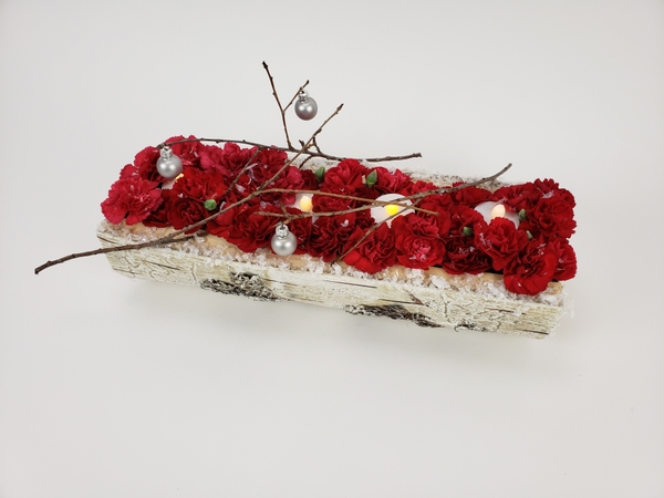 Red carnations for a rustic Christmas display