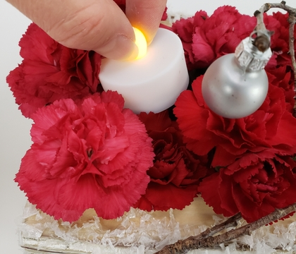 Craft a single legged wire nest to place a flameless candle into your design