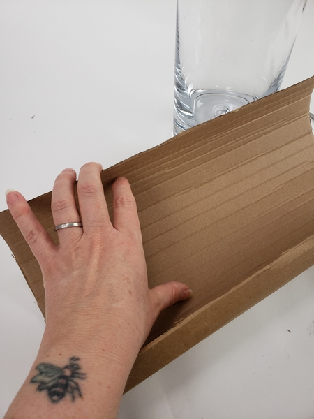 You will see horizontal folds in the cardboard