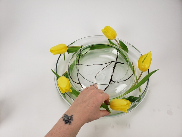 Spacing out the flowers to create a in a vase wreath