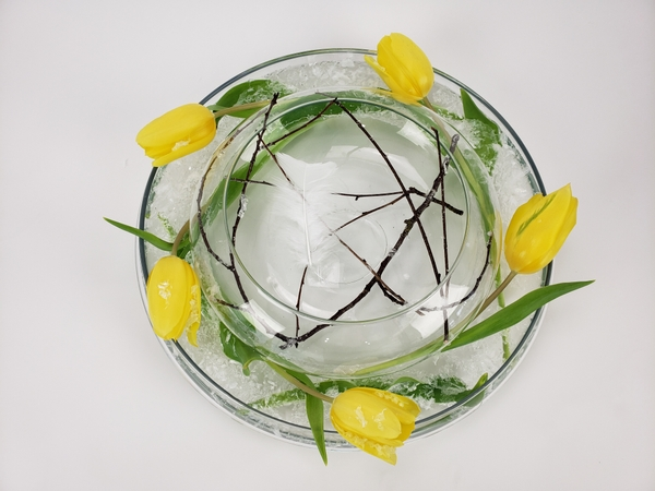 Using two glass vases to make a clear flower arrangement